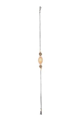 Gold Finish Metal Bead & Pearl Rakhi by SONNET