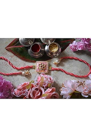 Gold Finish Pink Enameled & Kundan Rakhi by Sonnet