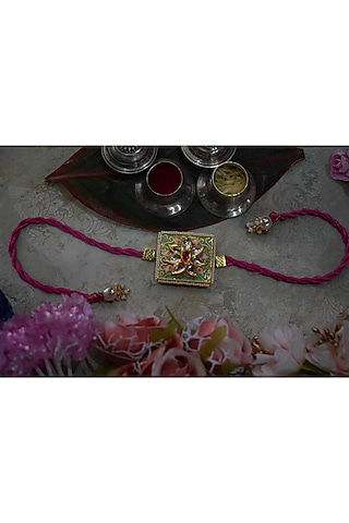 Gold Finish Green Enameled Rakhi by Sonnet