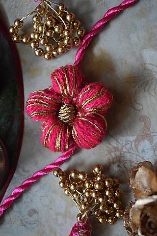 Pink Floral Thread Work Rakhi by Sonnet