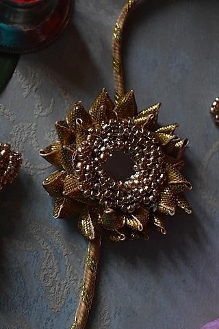 Gold Floral Pearl Rakhi by Sonnet