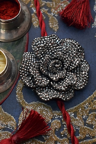 Black Finish Diamond Rakhi by Sonnet