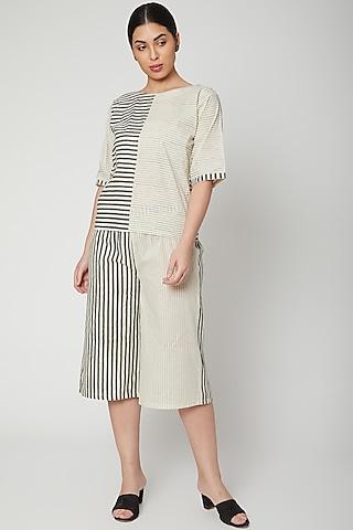 White & Black Printed Culotte Pants by Silk Waves