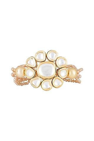 Matte Gold Finish Peach Crystal & Kundan Flower Adjustable Bracelet by Shillpa Purii
