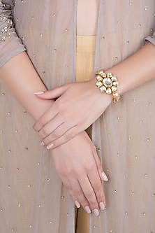 Matte Gold Finish Peach Crystal & Kundan Flower Adjustable Bracelet by Shillpa Purii