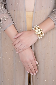 Matte Gold Finish 3 Line Pearls & Kundan Adjustable Bracelet by Shillpa Purii