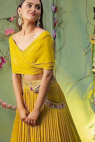 Yellow Embroidered Skirt Set With Belt Bag by studio miku kumar