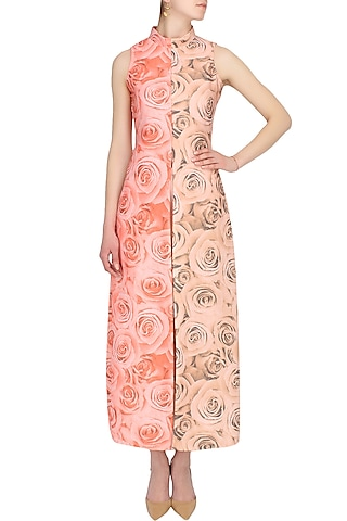 Solid peach and soothing red rose print cape and trouser pants set by Shainah Dinani