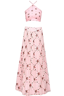 Pink floral printed halter neck crop top and flared skirt set by Shainah Dinani