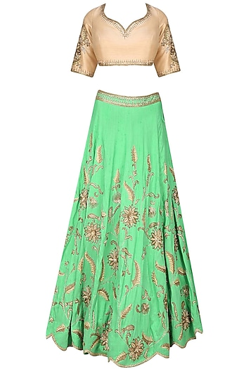 Mint green birds and flowers embroidered lehenga and cream blouse set by Sanna Mehan
