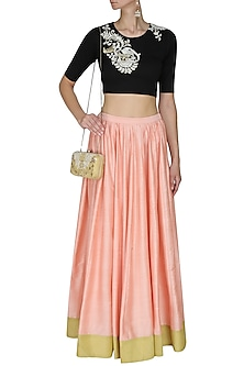 Black floral embroidered crop top and peach skirt set by Sonali Gupta