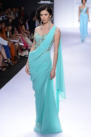 Turquoise embroidered sari-gown by Sonaakshi Raaj