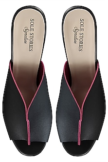 Black with a pink two toned mules by SOLE STORIES