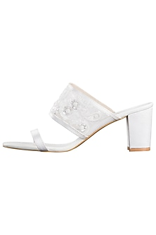 White embroidered block heels by SOLE STORIES