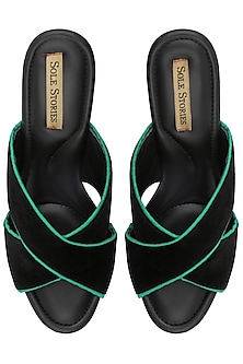 Black criss cross mules by SOLE STORIES