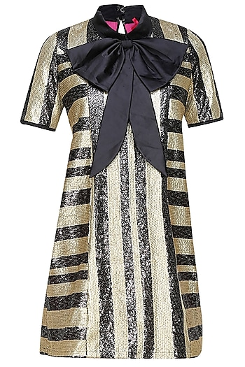 Black and gold striped shift dress with a dramatic bow by Sonam Parmar