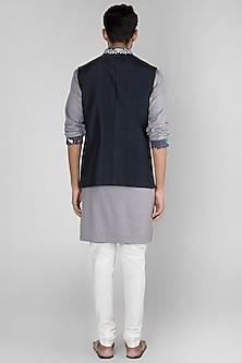 Navy Blue Embroidered Bundi Jacket by SEIRRA THAKUR