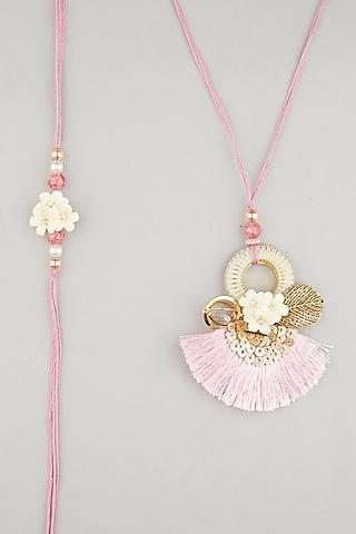 Pink Floral Thread Rakhis (Set of 2) by Surabhi Arya
