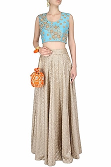 Blue sleeveless blouse with golden floral embroidered motifs by Surabhi Arya