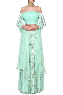 Sea Green Off Shoulder Fringes Blouse with Embroidered Lehenga by Suvi Arya