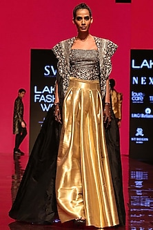 Black Corset Bustier With Cape & Gold Pleated Skirt by SVA BY SONAM & PARAS MODI