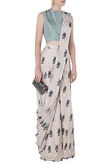 Beige Printed Drape Saree with Teal Crop Top by Arya by SVA