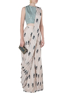 Beige Printed Drape Saree with Teal Crop Top by Arya by SVA