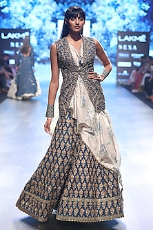 Blue Short Jacket with Ivory Asymmetrical Draped Blouse and Embroidered Lehenga by SVA BY SONAM & PARAS MODI