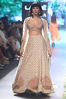 Beige Embroidered Lehenga with Cape Set by SVA BY SONAM & PARAS MODI