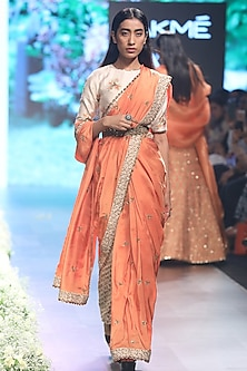 Orange Embroidered Saree with Beige Dahlia Print Blouse, Pants and Belt by SVA BY SONAM & PARAS MODI