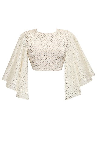 Off white cutwork bell sleeves crop top by SVA BY SONAM & PARAS MODI