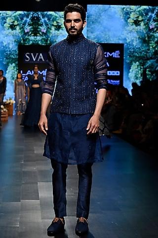Midnight Blue Embroidered Bundi Jacket With Kurta & Pants by SVA BY SONAM & PARAS MODI Men