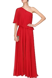 Crimson red one shoulder retro flared cape gown by Swatee Singh