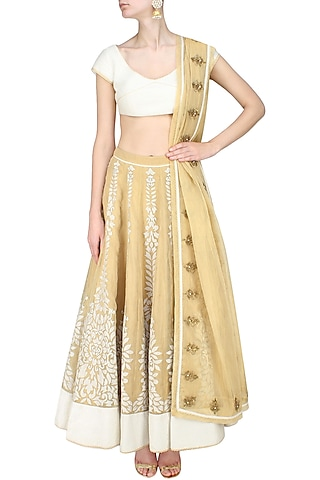 Gold floral chanderi applique work lehenga and corset blouse set by SWGT By Shweta Gupta