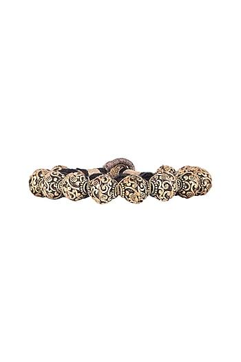 Gold Finish Metal Balls Antique Bracelet by Tanvi Garg