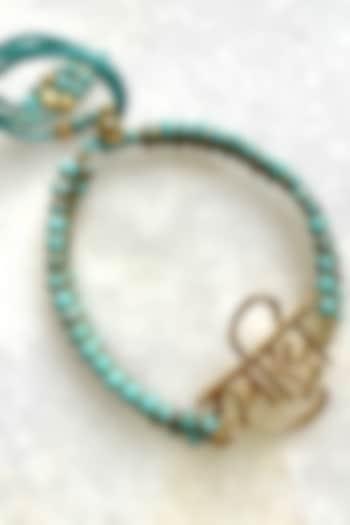 Turquoise Blue Thread Rakhi by Tanvi Garg