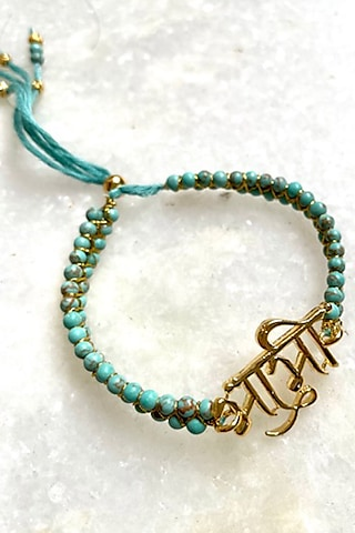 Turquoise Blue Bhabhi Thread Rakhi by Tanvi Garg