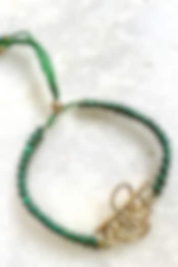 Green Brass Thread Rakhi by Tanvi Garg