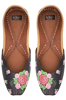 Black floral hand painted juttis by THE HAELLI