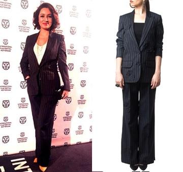 Grey pinstriped jacket and palazzo pant set by Huemn