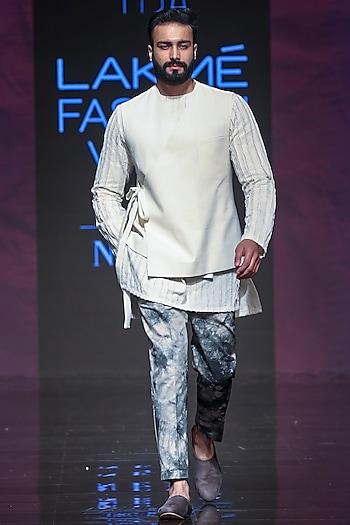 Ivory Kurta Set With Bandi Jacket by TISA