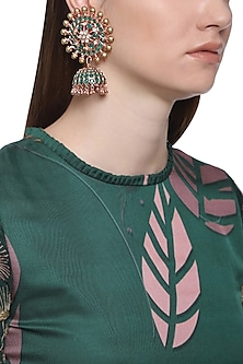 Gold plated kundan, emeralds and shell pearl earrings by Tanzila Rab