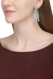 Silver plated white sapphire and shell pearl dangler earrings by Tanzila Rab