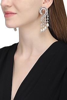 Silver plated white sapphire and shell pearl earrings by Tanzila Rab