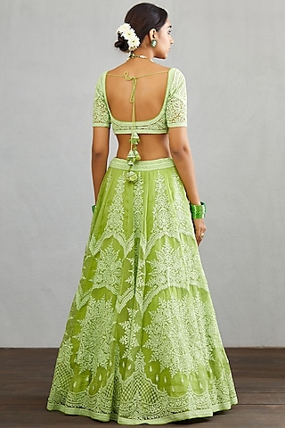 Green Embroidered Lehenga Set by TORANI