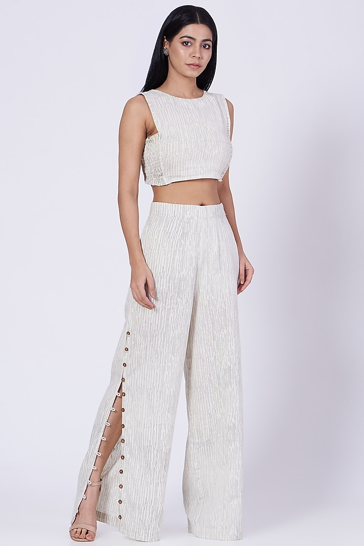 Off-White Block Printed Flared Pants by Three Piece Company