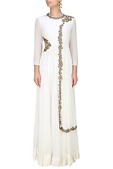 White Anarkali with draped dupatta and side cutout by Tanya Patni