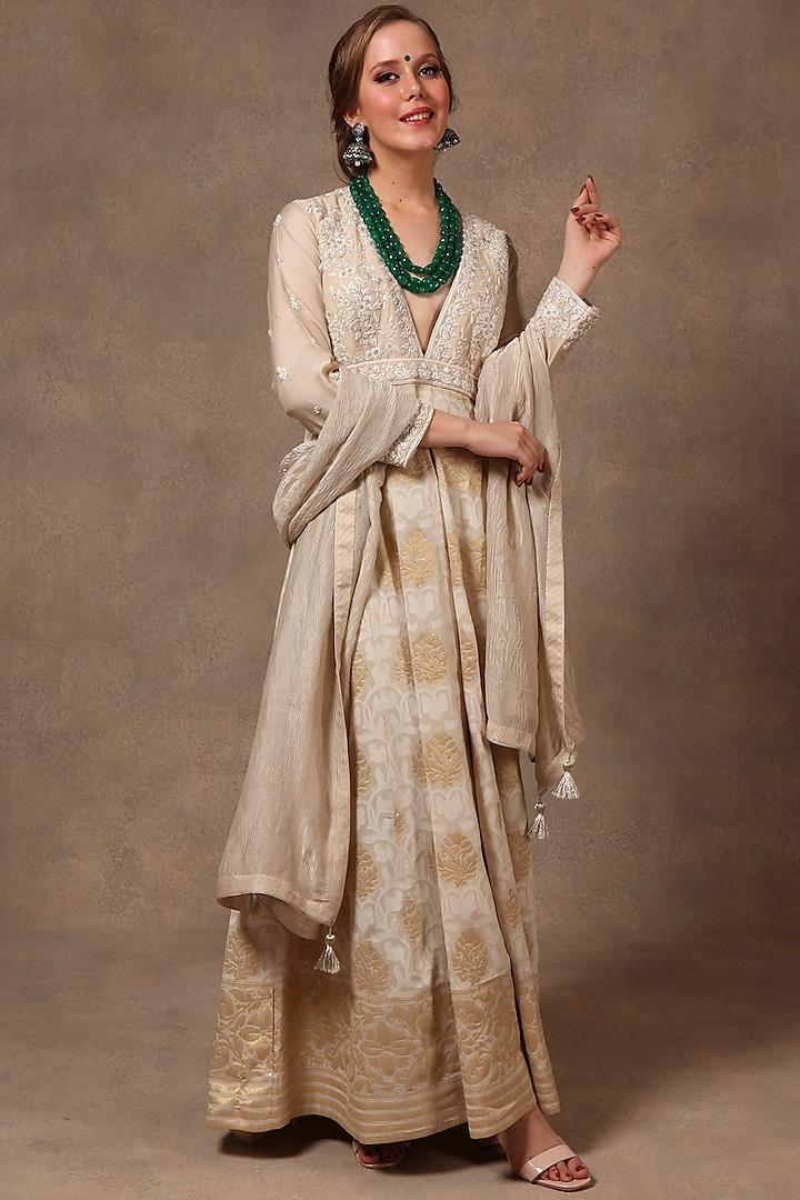 Beige Embroidered Anarkali Set by Trisvaraa