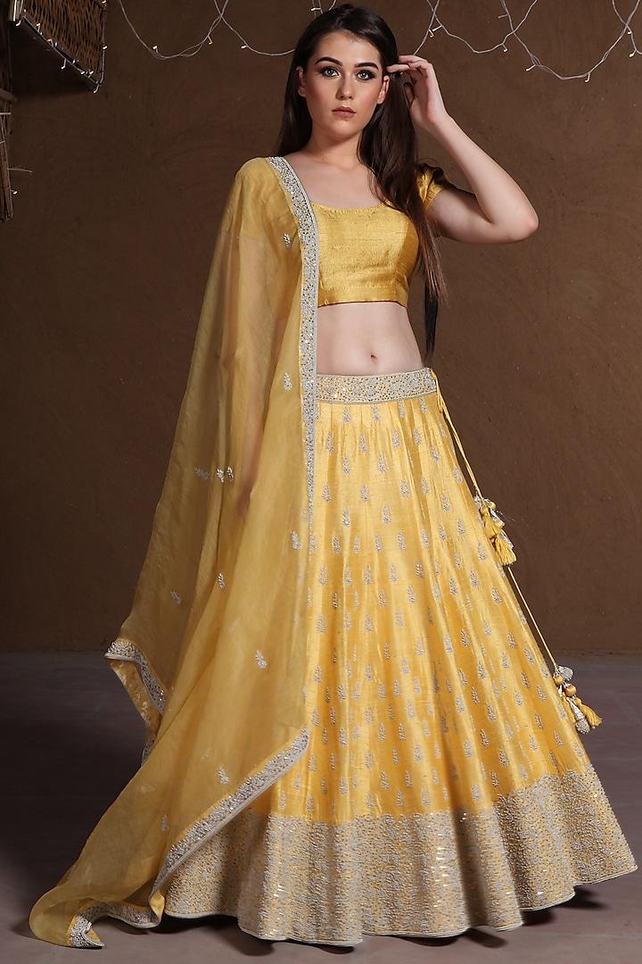 Yellow Embroidered Lehenga Set by Trisvaraa