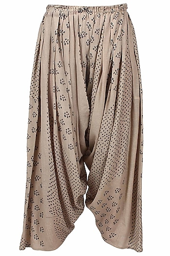 Ivory shibori printed pleated salwar pants by Urvashi Kaur